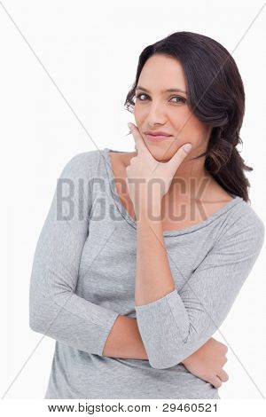 Close up of woman in thinkers pose against a white background