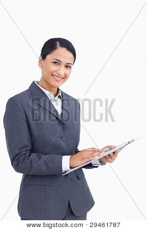Close up of saleswoman with pen and clipboard against a white background