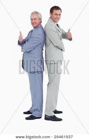 Tradesmen standing back to back giving thumbs up against a white background