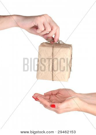 Man's hand giving parcel with blank heart-shaped label to woman isolated on white