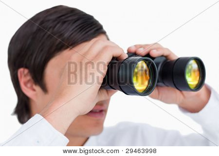 Close up side view of tradesman with spy glass against a white background