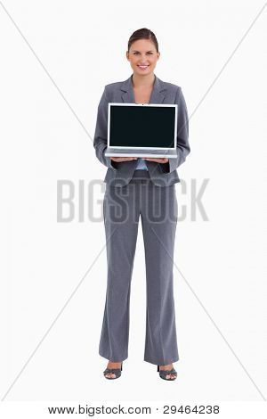 Smiling tradeswoman presenting her laptop screen against a white background