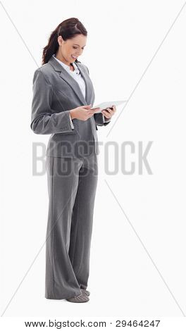 Profile of a businesswoman smiling while watching a touch pad against white bacground