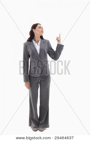 Businesswoman presenting a product on the top against white background