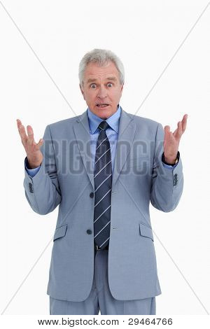 Shocked mature tradesman against a white background