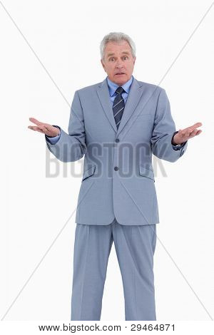 Irritated mature tradesman against a white background