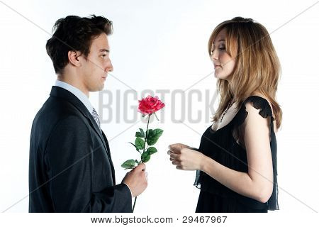 man gives a woman flowers