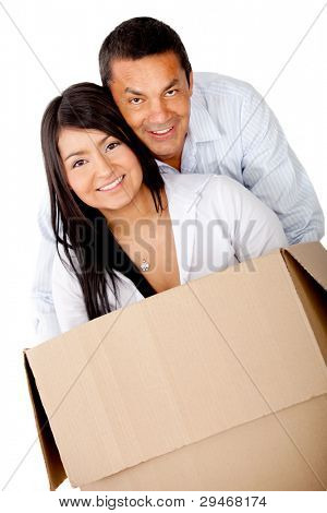 Loving couple moving house and packing in boxes - isolated over white