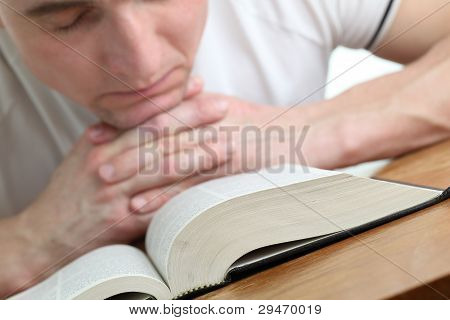 Man praying with the Bible