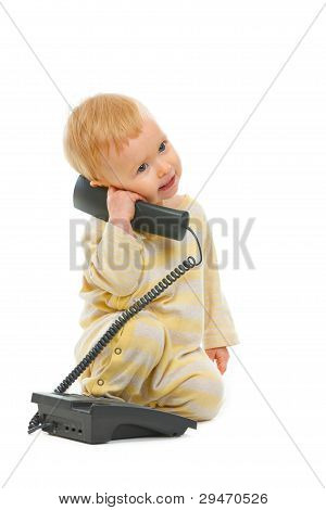 Cute Baby Speaking On Phone Isolated On White