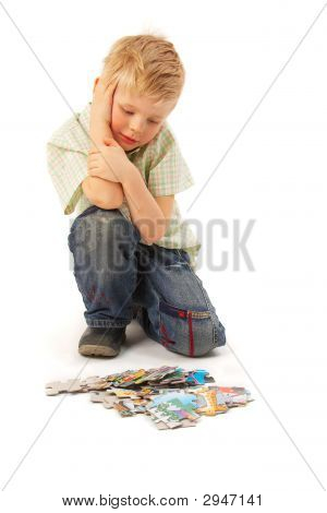 Boy With Puzzles. Thinking...