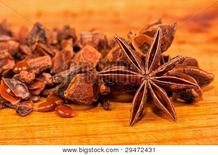 Star Aniseed Lying On A Wooden Board