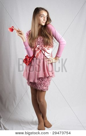Teenage Girl In Pink With Plush Heart