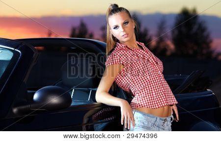Sexy woman posing next to sport car