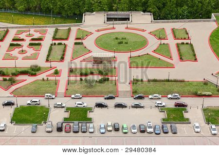 Top view of parking with parked cars; green grass and footpaths
