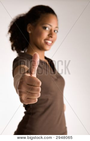 Woman Is Holding Her Thumb Up