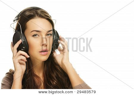 young brunette woman listening to music