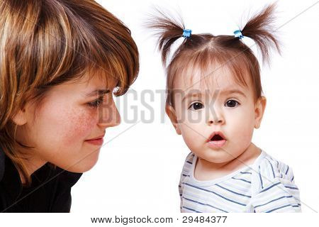 Happy woman looking at her daughter, over white