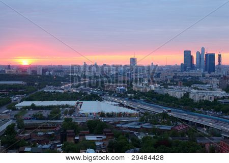 MOSCOW - MAY 15: Sunset and panorama of city, on May 15, 2011 in Moscow, Russia. Moscow authorities have banned the installation of advertising designs on facades of buildings and fences.