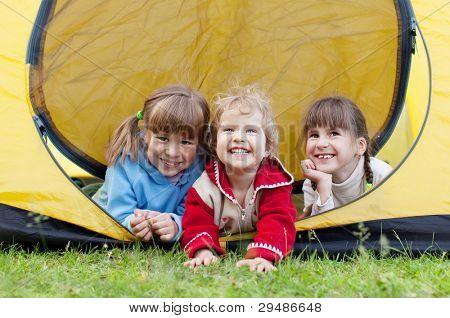 Happy children in tent. Family outdoors