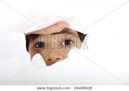 boy looks into the hole in the sheet of paper