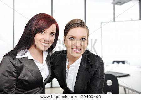 Portrait of two businesswomen in business meeting at office