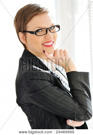 Beautiful business woman with short hair and glasses