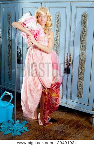 fashion vintage blond housewife with mop cleaning chores at home
