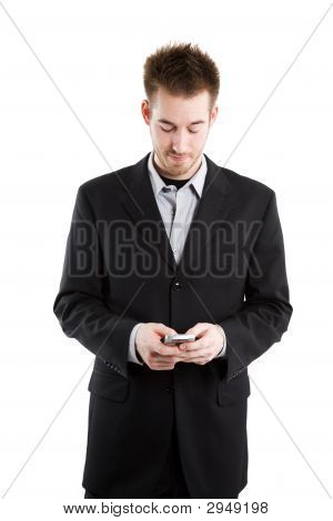 Texting Caucasian Businessman