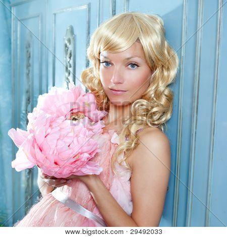 blond fashion princess and vintage spring flowers dress on blue wardrobe