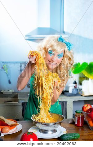 Blonde funny on kitchen with pasta and fashion blue makeup
