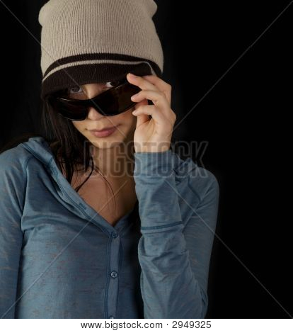 Young Woman Peeks Through Sunglasses