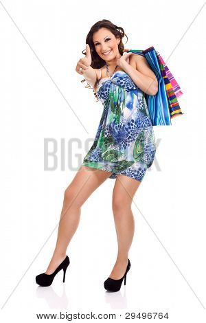 sexy, happy shopping girl, showing thrum up, isolated on white background