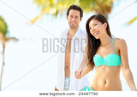 Beach bikini woman. Beautiful gorgeous young mixed race bikini model in swimsuit smiling happy enjoying view on beach resort on tropical beach. Asian / Caucasian female model in Varadero, Cuba