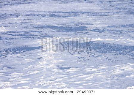 Snow Hummocks On Frozen Reservoir