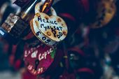 Close Up Of A Love Lock On A Railing On A Locks Bridge With Other Locks Blurred To Create A Bokeh Ba poster