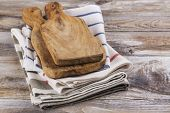 Clean Kitchen Towels And Wooden Olive Cutting Board On Kitchen Table. Copy Space poster