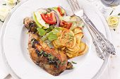 Chicken leg grilled with chips and salad