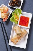 stock photo of lumpia  - spring rolls with tempura and sauce - JPG