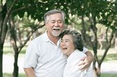 Happy Love Elderly Couple Smile Face , Senior Couple Old Man And Senior Woman Relaxing Hug In A Fore poster