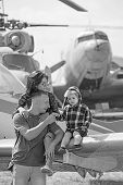 Live A Life You Love. Happy Family Vacation. Woman And Man With Boy Child At Helicopter. Family Coup poster