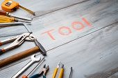 Set Of Work Tool On Rustic Wooden Background With Written tool In Space, Industry Engineer Tool Co poster