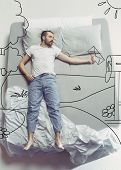 Postman Brings Good News. Top View Photo Of Young Man Sleeping In A Big White Bed At Home. Dreams Co poster