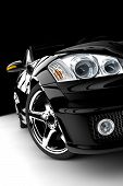 stock photo of headlight  - A modern and elegant black car illuminated - JPG
