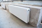 Close Up On House Construction Heating System And Radiator Heating. Installing Radiator Heating At H poster
