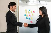 Business People Handshake Agreement In Office. poster