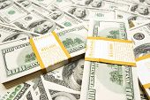 stock photo of ten thousand dollars  - Ten thousand dollar stacks on money background - JPG