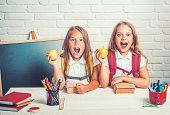 Happy School Kids At Lesson In September 1. Little Girls Eat Apple At Lunch Break. School Time Of Gi poster