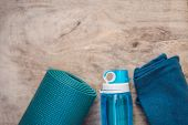 Everything For Sports Turquoise, Blue Shades On A Wooden Background. Yoga Mat, Sport Shoes Sportswea poster