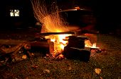 stock photo of boiling point  - Large pot boiling at fireplace with flickres around - JPG